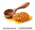 honeycomb with spoon in closeup   Shutterstock . vector #1160229685