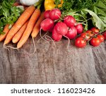 fresh vegetable on wooden table | Shutterstock . vector #116023426