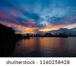 it is a beautiful sunset seen... | Shutterstock . vector #1160258428