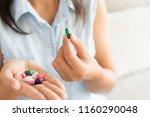 Woman Hand With Pills Medicine...