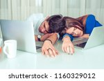 Small photo of Young man and woman couple colleagues lying on table with laptops and sleeping in laziness and procrastination in office sleeping. Overworking, late hours, night shift, sleepless, lazy workers concept