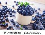 lots of fresh blueberries  ... | Shutterstock . vector #1160336392