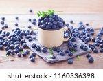 lots of fresh blueberries  ... | Shutterstock . vector #1160336398