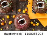 scary halloween donuts with... | Shutterstock . vector #1160355205