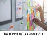 web designer brainstorming for... | Shutterstock . vector #1160365795