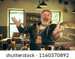 senior bearded man drinking...   Shutterstock . vector #1160370892