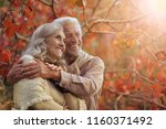 portrait of a happy senior... | Shutterstock . vector #1160371492