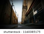urban back alley with stairway  ... | Shutterstock . vector #1160385175