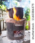 old cooking pot stove using... | Shutterstock . vector #1160386375