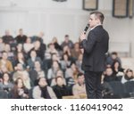 speaker conducts the business... | Shutterstock . vector #1160419042
