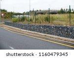 protection of the escarpment... | Shutterstock . vector #1160479345