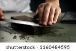 great chef is sharpening the... | Shutterstock . vector #1160484595