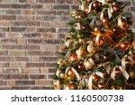 golden christmas tree on brick... | Shutterstock . vector #1160500738