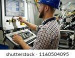portrait of machine operator...   Shutterstock . vector #1160504095