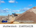 Small photo of dumps of mined rock with a system of belt conveyors and spreaders, general view