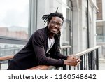 african man with dreadlocks and ... | Shutterstock . vector #1160548642