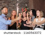 group of young friends holding... | Shutterstock . vector #1160563372