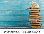 Stock photo open book hardback books on wooden table back to school copy space 1160563645