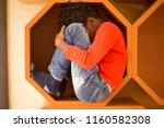 little boy sitting on... | Shutterstock . vector #1160582308