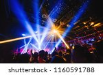 Stock photo silhouette of concert crowd in front of bright stage lights dark background smoke concert 1160591788