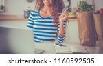 smiling woman online shopping...   Shutterstock . vector #1160592535