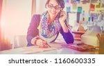 dressmaker woman designing...   Shutterstock . vector #1160600335