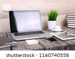 analyzing statistics on laptop... | Shutterstock . vector #1160740558