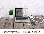 analyzing statistics on laptop...   Shutterstock . vector #1160754475