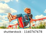 happy teenager girl on a swing. ... | Shutterstock . vector #1160767678