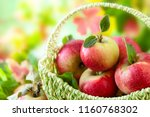 fresh ripe red apples in basket ... | Shutterstock . vector #1160768302