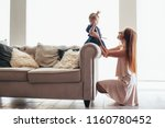 mom with daughter playing in... | Shutterstock . vector #1160780452