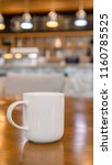 cup of coffee on table | Shutterstock . vector #1160785525