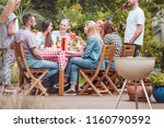 people gathered around a wooden ... | Shutterstock . vector #1160790592