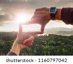 hands framing view distant over ... | Shutterstock . vector #1160797042