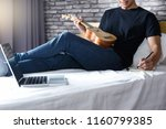 young man write a song or music ... | Shutterstock . vector #1160799385