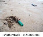 lighter trashed on the sand... | Shutterstock . vector #1160803288