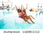 three cheerful young women in... | Shutterstock . vector #1160811112