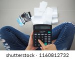 Small photo of Women sit stressed with the calculator calculates receipts expenses. To repay credit card debt.