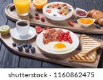 breakfast with yogurt  eggs ... | Shutterstock . vector #1160862475