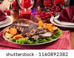 roasted pork loin with baked... | Shutterstock . vector #1160892382