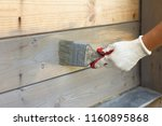 hand in glove with a brush on... | Shutterstock . vector #1160895868