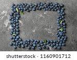 frame made of ripe blueberries... | Shutterstock . vector #1160901712