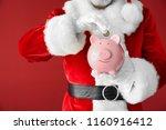 santa claus putting coin into... | Shutterstock . vector #1160916412