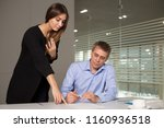 man and woman working in bright ... | Shutterstock . vector #1160936518