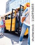 multiethnic teen students... | Shutterstock . vector #1160956855