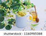 cup of linden tea and linden... | Shutterstock . vector #1160985388