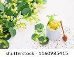 cup of linden tea and linden... | Shutterstock . vector #1160985415
