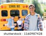 happy teen african american... | Shutterstock . vector #1160987428