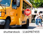 senior school bus driver... | Shutterstock . vector #1160987455