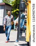 multiethnic teen schoolboys... | Shutterstock . vector #1160987458